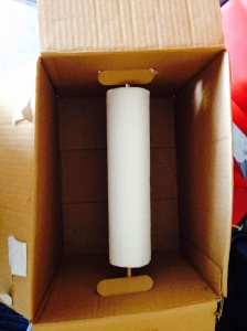 Dowel rod through both box holes and the paper towel tube