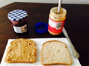 Spread the peanut butter on a slice of bread