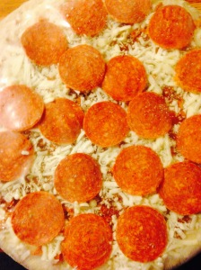 Remove the pizza from the plastic. Make sure you remove all non-pizza items from your pizza before cooking.