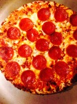Let your pizza cook before you cut it. Don't remove the grease. It's flavorful.